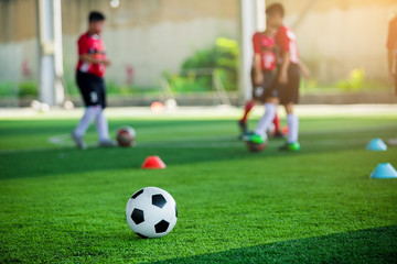 soccer ball on green artificial turf