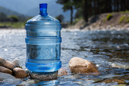 Water big bottle on mountains and rivers background