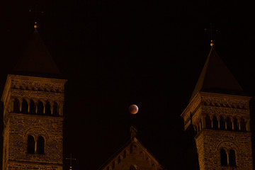 The Super Blood Wolf Moon eclipse of January 21, 2019 taken in Maastricht, the Netherlands with in the foreground the Basilica of Saint Servatius