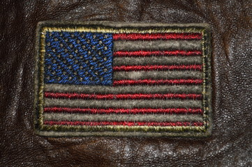 American flag embroidered on brown leather