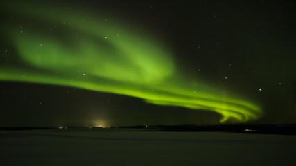 Northern light (aurora borealis) in the horizon above Ivalo from Saariselka in Finnish Lapland.