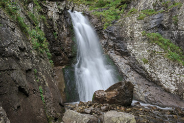 Closeup view waterfall scenes in mountains, national park Dombai, Caucasus