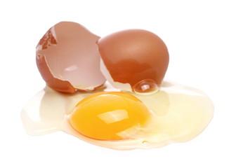 Cracked egg, eggshells with yolk isolated on white background