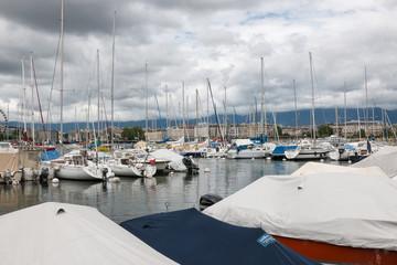 View on Geneva lake with boats and city Geneva, Switzerland