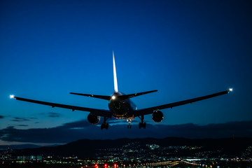 Jet plane landing scene at dusk (夕暮れのジェット旅客機着陸シーン)