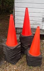 Orange Traffic Cones in Three Stacks