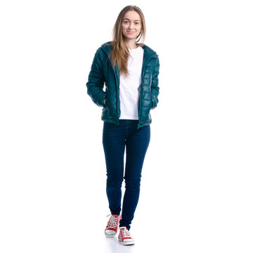 Woman in jeans and jacket walking goes looking on white background. Isolation