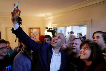 Democratic 2020 U.S. presidential candidate Cory Booker  takes a selfie with audience members in Rochester