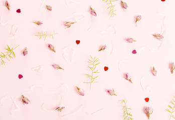 Festive flower composition on pink background. Overhead view