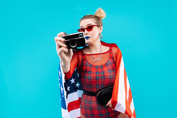 Woman with two little hair buns holding flag of her country
