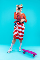 Blonde-haired woman with flag over her waist making photo