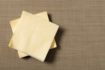 Paper napkin on textured background.