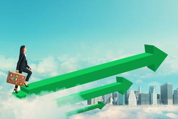 Businesswoman walking on green arrows