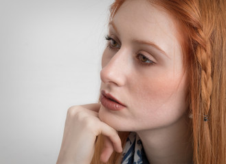 Expressive portrait of a beautiful girl with red hair and green eyes