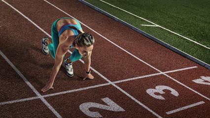 Sport backgrounds. Sprinter starting on the sport arena.