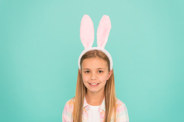 Styling in her Sundays best. Cute little girl wearing bunny ears headband. Small girl child in easter bunny style. Fashion accessory for easter costume party. Looking pretty in easter bunny attire