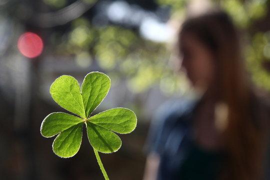 woman holding green leaf