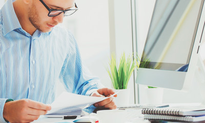 Business man working at office with laptop and documents on his desk, consultant lawyer concept