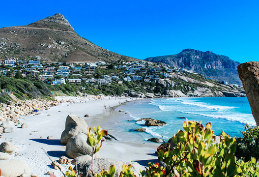 Scenic landscape of Llandudno Beach with white sand and turquoise water in Cape Town, South Africa