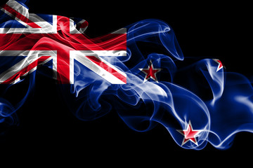 National flag of New Zealand made from colored smoke isolated on black background. Abstract silky wave background.