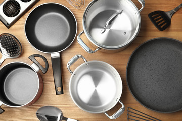 Flat lay composition with clean cookware on wooden background Wall mural
