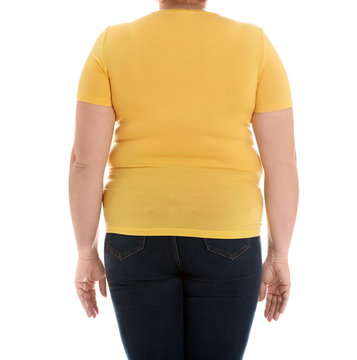 Overweight woman on white background, closeup. Weight loss