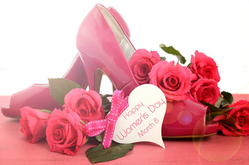 International Women's Day, March 8, ladies pink high heel stiletto shoes and roses on vintage pink wood background, with lens flare