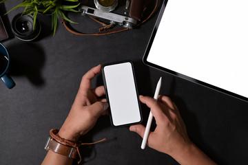 Stylish holding mobile smart phone on desk
