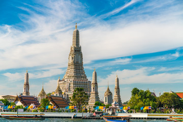 Temple of dawn Wat Arun with boat blue sky sunny day