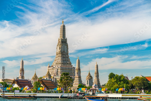 Wall mural Temple of dawn Wat Arun with boat blue sky sunny day