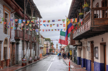 A view of a typical colonial style street in La Candelaria neighborhood, Bogota, Colombia.