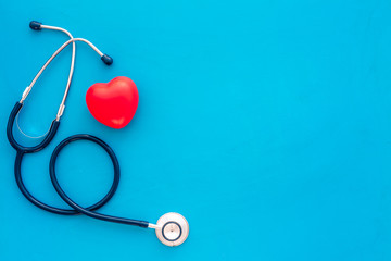 Obraz Heart health, health care concept. Stethoscope near rubber heart on blue background top view space for text - fototapety do salonu
