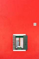 Fototapete - Decorated window on red color wall in Burano island, Venice, Italy