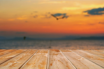 Empty top of wooden table and view of sunset or sunrise background. For product display.