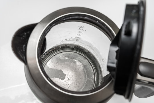 Limescale at the bottom of kettle - hard water concept