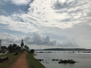 Clouds over Lighthouse and Indian Ocean in Galle, Sri Lanka