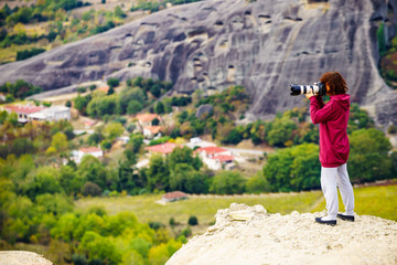 Woman take photo from Meteora monastery