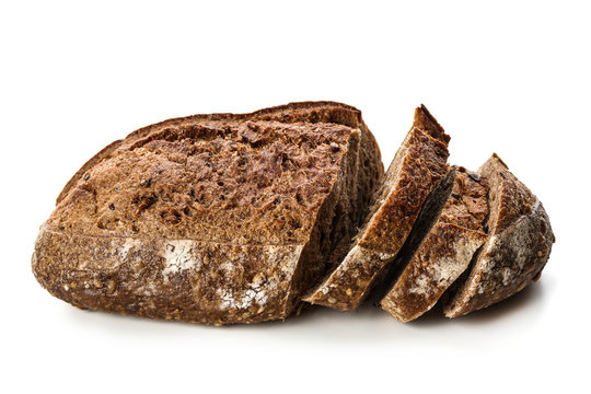 Cut loaf of fresh bread on white background