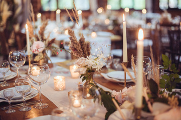 Fototapeta rustic wedding decorations with flowers and candles. banquet decor. picture with soft focus obraz