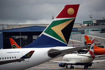 Logo of SAA is seen on an aircraft at O.R. Tambo International Airport in Johannesburg
