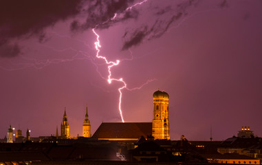 lightning strikes into munich cathedral Frauenkirche while thunderstorm. travel bavaria germany skyline München