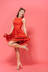 Full length portrait of a beautiful young pin-up girl