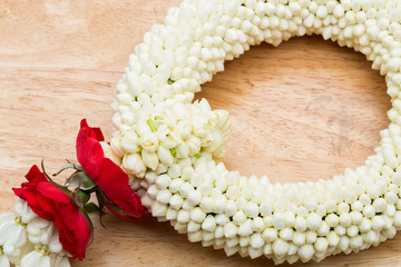 Many Malai off white rak flower in round blossom shape for hand held, put on wooden table, studio lighting white background copy space for text logo
