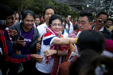 Sudarat Keyuraphan, Pheu Thai Party and Prime Minister candidate greets her supporters during an election campaign in Ubon Ratchathani Province