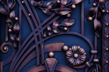 Decoration of metal gates with forged elements