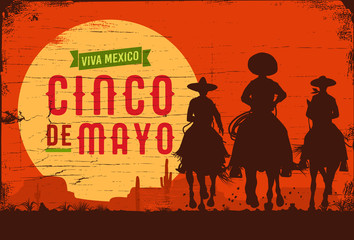 Cinco de Mayo, Traditional Mexico holiday, Silhouette of three Mexican cowboys riding horses on a wooden board