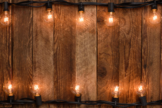 Vintage garland on old rustic wooden wall background