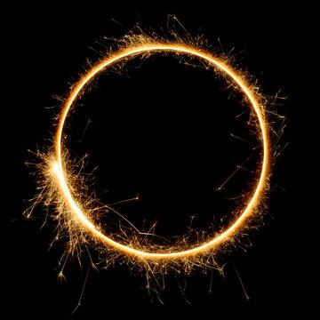 Shiny sparkler circle shape. Burning bengal fire round letter o number zero, long exposure. Burning sparklers isolated on black.
