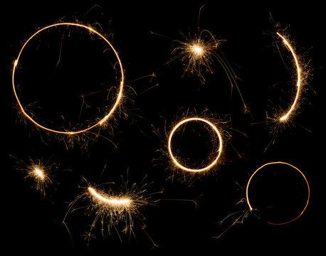 Sparkler design elements. Bengal fire stars fireworks set isolated on black.