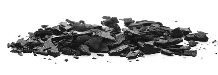 Black charcoal chunks, pile isolated on white background
